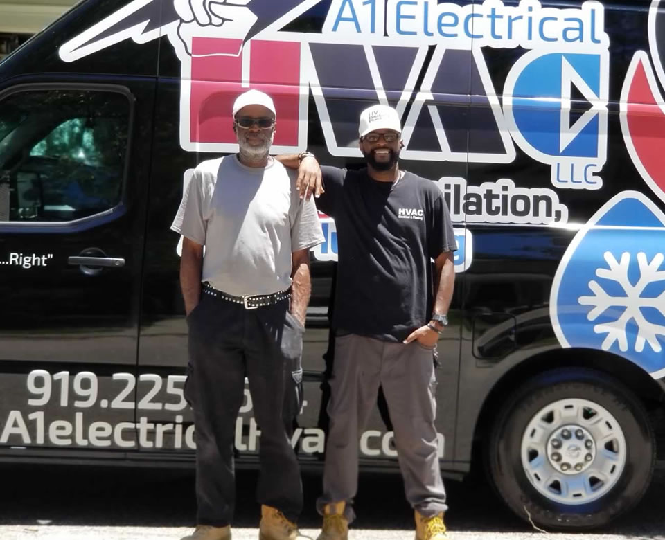 William Taylor Sr. and Jr. Standing Outside A1 Electrical HVAC Service Truck.